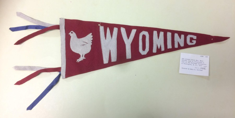 "red pennant with ""Wyoming"" and a chicken"