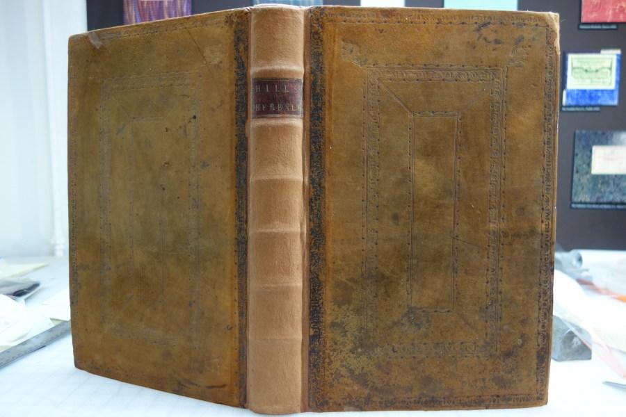 The British Herbal book spine after restoration work.