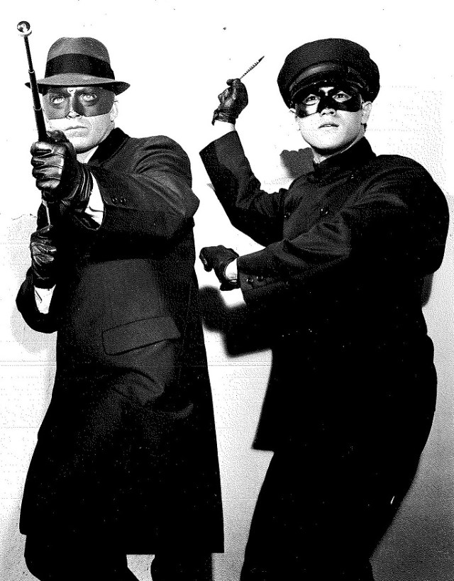 "Van Williams (The Green Hornet) and Bruce Lee (Kato) in fighting stance for a publicity still for the television series ""The Green Hornet,"" 1966. William Dozier papers, UW American Heritage Center."