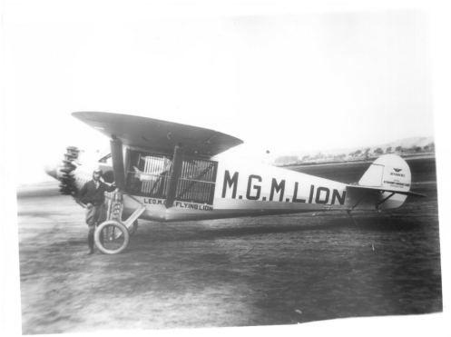 Martin Jensen with the plane that carried Leo the Lion as part of an MGM publicity stunt, 1927. Box 1, Martin Jensen papers, American Heritage Center, University of Wyoming.
