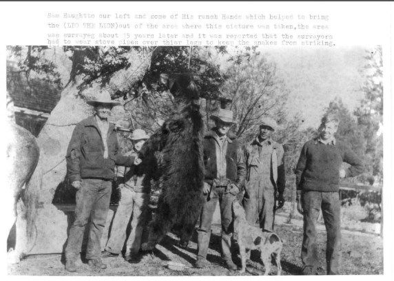 "Martin Jensen captioned this photo, ""Sam Haughton on left and some of his ranch hands which helped to bring the (Leo the Lion) out of the area where this picture was taken. The area was surveyed about 15 years later and it was reported that the surveyors had to wear stove pipes over their legs to keep the snakes from striking."" Box 1, Martin Jensen papers, American Heritage Center, University of Wyoming."
