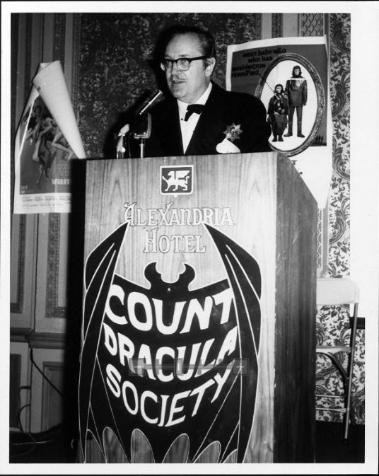 Forrest Ackerman speaks to a meeting of the Count Dracula Society, which was founded in 1962 for the study of horror films and Gothic literature, ca. 1960s.