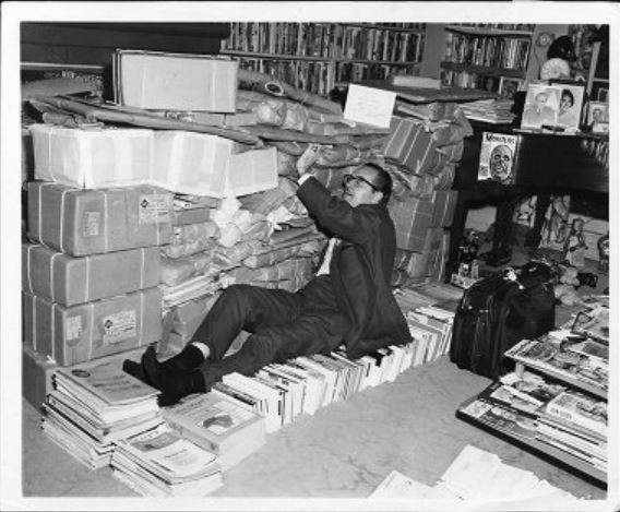 "Forrest Ackerman engulfed in sci-fi memorabilia in his home which he called the ""Son of Ackermansion,"" ca. 1960s"