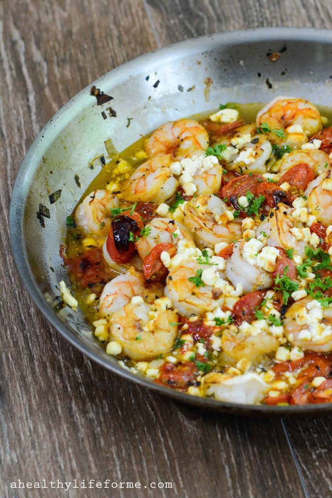 Baked Shrimp with Tomato and Feta is an easy, delicious, gluten free and healthy dinner that is made in one skillet and ready in less than 30 minutes.