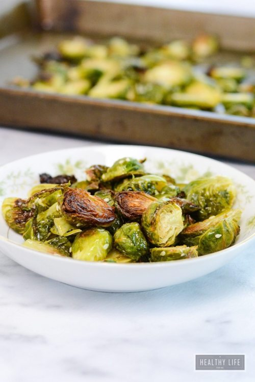 Maple Sesame Roasted Brussels Sprouts are sweet and nutty in flavor. They take minutes to prepare and are ready in less than 30 minutes | ahealthylifeforme.com
