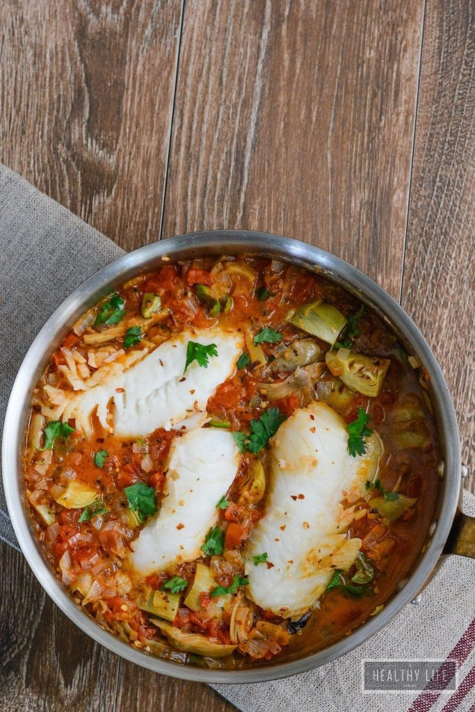 Cod with Bacon Tomato and Artichoke healthy recipe that is prepared in one pot recipe | ahealthylifeforme.com