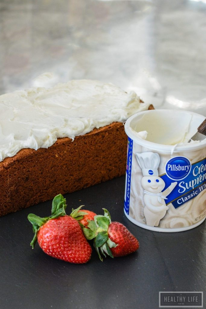 Gluten Free yellow cake with fresh banana flavor topped with a classic white frosting makes the perfect dessert cake or decadent breakfast cake.