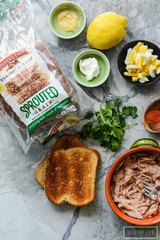 This Yellowfin Tuna Salad Sandwich made with high quality tuna, egg, dijon, a bit of spice all on top of a perfectly toasted piece of bread may be the best tuna salad sandwich ever. High protein, low calorie makes this is the perfect lunch or light dinner recipe   ahealthylifeforme.com