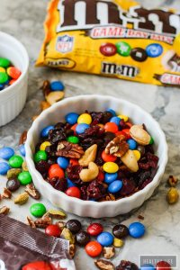 Everyone needs a quick go to Game Day Trail Mix that is easy to throw together, tastes delicious because it contains nuts, berries and M&M's. | ahealthylifeforme.com