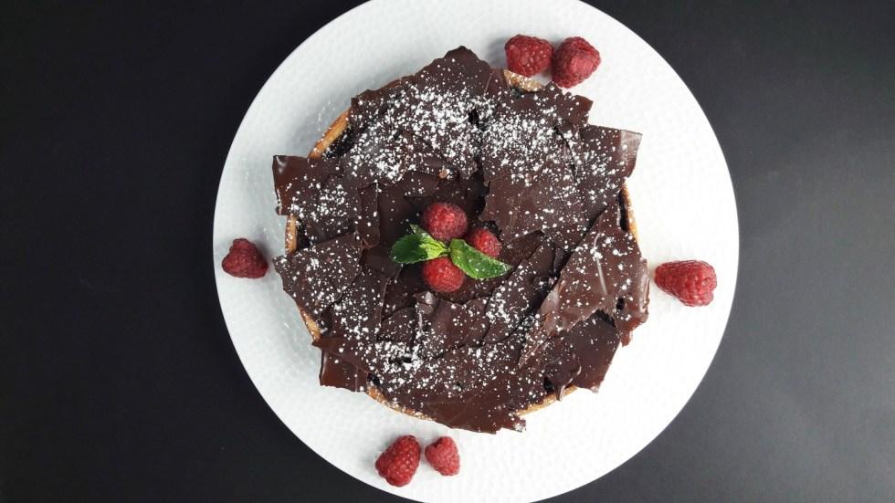 Chocolate ganache and raspberry caramel shortbread tart