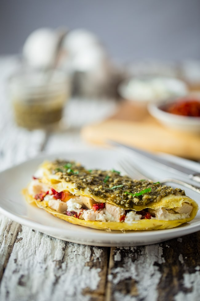 Romantic breakfast ideas for Valentine's Day? Pesto egg white omelette with goat cheese. | ahedgehoginthekitchen.com