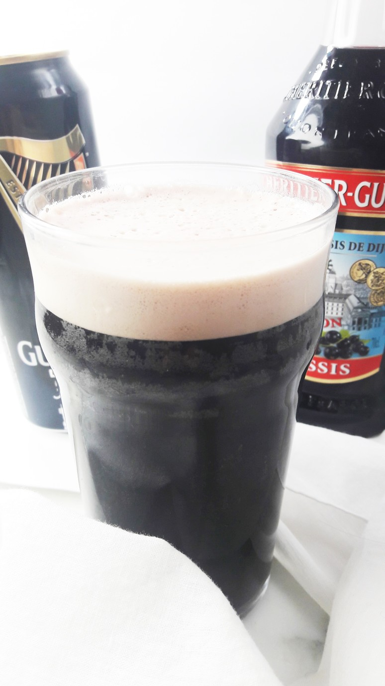 Blackcurrent and Guinness Cocktail Recipe. This is easy and delicious and perfect for St. Patrick's Day! | ahedgehoginthekitchen.com