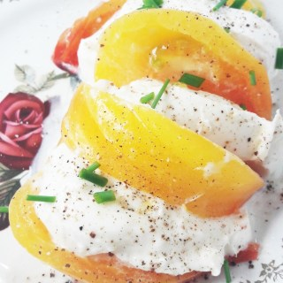 Heirloom yellow tomato mozzarella salad