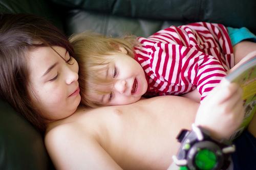 Willa cuddling while Xavier reads...