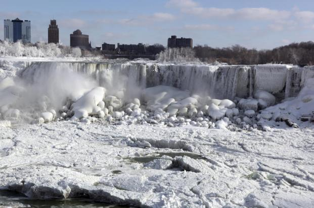 Ice and ice flows on the Canadian and US water falls at Niagara Falls, in the State of New York, USA, on January 9, 2014 following the recent cold weather that has moved across the United States midwest and northeast. (EPA/RICK WARNE)