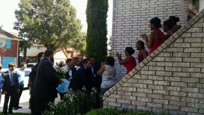 The Groom trying to convince the Bride's family to let him in their home.
