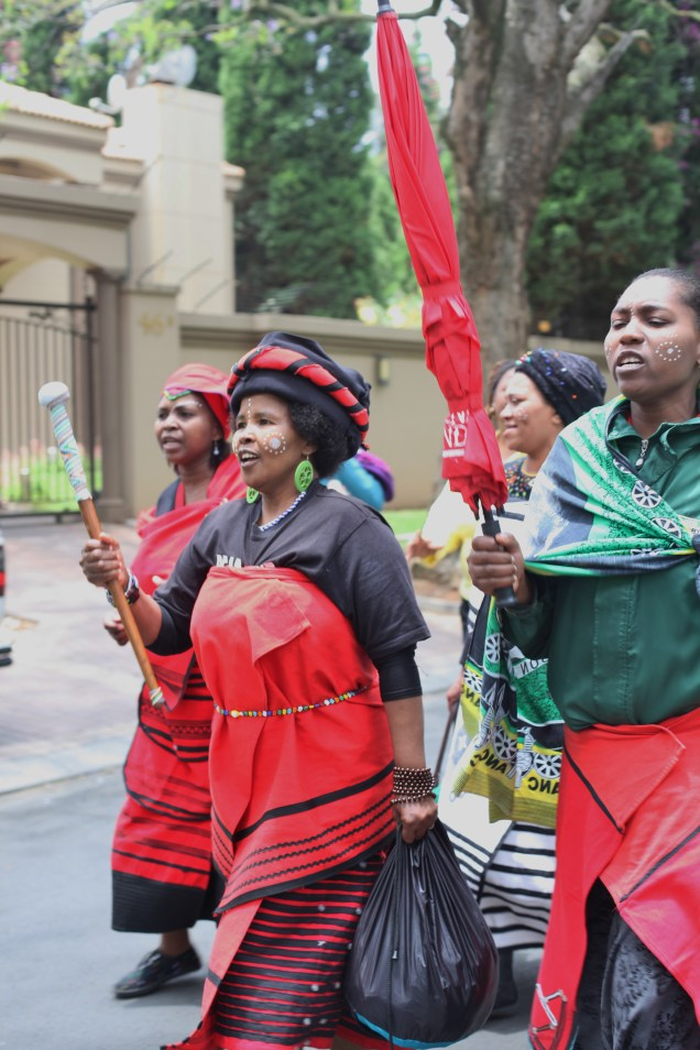 These woman arrived as I did. They were signing praise songs for Mandela as they walked down the road towards his house.