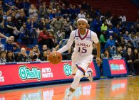 Guard Aisia Robertson, a sophomore from San Francisco, California, dribbles the basketball at Allen Fieldhouse during the basketball game against Fort Hays State on Oct. 30. The Jayhawks won 98-71. Ashley Hocking/KANSAN