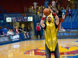 A KU student dressed as a banana shoots a basket during half time at the the women's basketball game against Fort Hays State on Oct. 30. KU won 98-71. Ashley Hocking/KANSAN