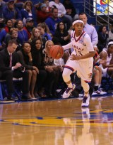 Sophomore Aisia Robertson, a guard from San Francisco, Calif., dribbles the basketball during the women's basketball game at Allen Fieldhouse on Nov. 23 against Oral Roberts University. The Jayhawks won 64-56. Ashley Hocking/KANSAN