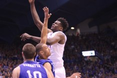 Center Udoka Azubuike, a freshman from Delta, Nigeria, jumps in the air to gain possession of the ball during the game on Nov. 25. Azubuike netted a career-high of 17 points. Kansas beat UNC Asheville 95-57 at Allen Fieldhouse. Ashley Hocking/KANSAN