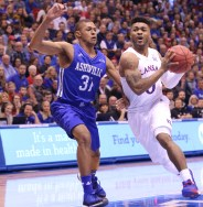 Guard Frank Mason, a senior from Petersburg, Virginia, prepares to do a layup during the first half of the basketball game against UNC Asheville on Nov. 25. The Jayhawks won 95-57 at Allen Fieldhouse. Ashley Hocking/KANSAN