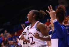 Guard Chayla Cheadle, a junior from Columbia, Mo., cheers from the sidelines when the Jayhawks win the women's basketball game against North Dakota on Nov. 27. Kansas won 76-71 in overtime. Ashley Hocking/KANSAN