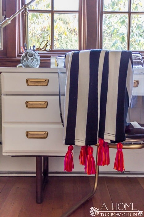 Turn this versatile and inexpensive Ikea blanket into a must-have home decor accessory! It's such an easy update that makes quite a statement. Click to learn how!