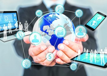 Businessman holds modern technology in hands.