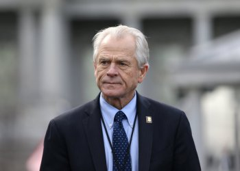 White House trade adviser Peter Navarro listens to a news conference about a presidential executive order relating to military veterans outside of the West Wing of the White House in Washington, U.S. March 4, 2019. REUTERS/Leah Millis