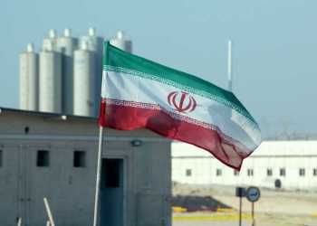 A picture taken on November 10, 2019, shows an Iranian flag in Iran's Bushehr nuclear power plant, during an official ceremony to kick-start works on a second reactor at the facility. - Bushehr is Iran's only nuclear power station and is currently running on imported fuel from Russia that is closely monitored by the UN's International Atomic Energy Agency. (Photo by ATTA KENARE / AFP)
