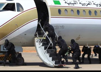 **  FILE  **  In this Thursday, July 31, 2008 file picture Libyan anti-terrorism special forces attack a Libyan airline plane during a training exercise at their camp in Tripoli, Libya. A Sudanese hijacked  passenger plane landed in Libya Tuesday, Aug. 26, 2008, after leaving the town of Nyala in Darfur.  A man holding a knife hijacked the plane carrying more than 100 people a security official said. The passenger plane was diverted to Libya after Egyptian authorities refused it entry, said the official, who described the hijacking from inside the Nyala airport, where the plane took off.  (AP Photo/ Abdel Magid Al Fergany/file)