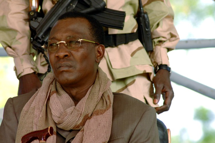 FILE PHOTO: Chad President Idriss Deby watches a rally in N'Djamena April 15, 2006. Deby's supporters paraded victoriously through the streets of the capital N'Djamena on Saturday but many nervous residents feared rebels fighting to topple him may return. REUTERS/Claire Soares/File Photo