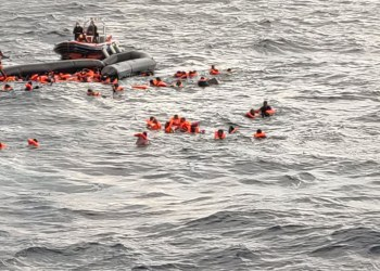 A still image taken from a video shows migrants at sea waiting to be rescued by Spanish search and rescue ship Open Arms during a search and rescue (SAR) operation in the Mediterranean Sea, November 11, 2020. Open Arms/Handout via REUTERS ATTENTION EDITORS THIS IMAGE HAS BEEN SUPPLIED BY A THIRD PARTY. NO ARCHIVE. NO RESALE.