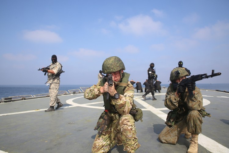 Members of the Russian and Iranian navy participate in a joint naval exercise in the Indian Ocean, Iran February 17, 2021. Iranian Army/WANA (West Asia News Agency) via REUTERS ATTENTION EDITORS - THIS IMAGE HAS BEEN SUPPLIED BY A THIRD PARTY.