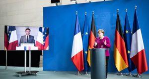 Merkel y Macron.