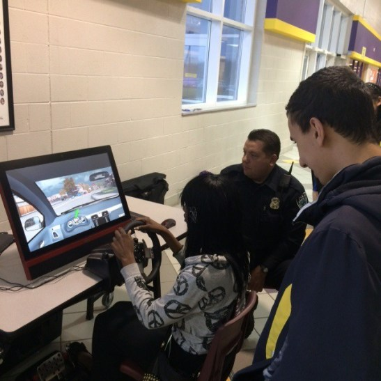 Directed Patrol Officer Jeff Malone demonstrating the simulator.