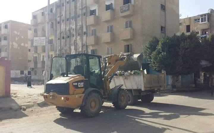 تطوير شارع مدرسة محمد حافظ ورفع مخلفات الاشجار والقمامة من شوارع حي السويس