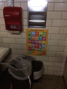 Preschool bathroom is part of girls locker room.