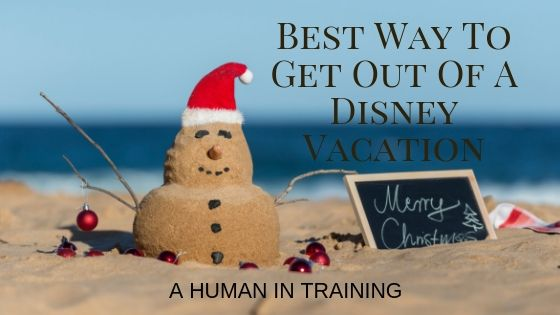 a snowman made out of sand with a Santa hat that is happy to get out of a Disney vacation
