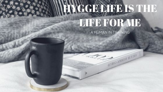 cup of coffee and warm blankets, depiction of the hygge life