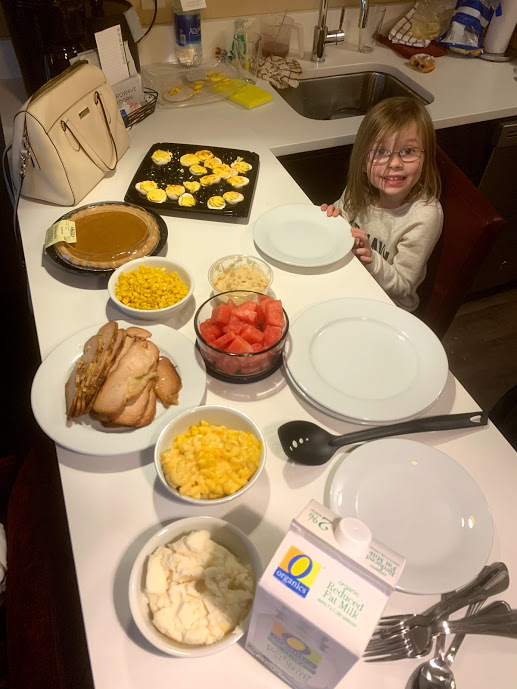 Child at a table with a Thanksgiving dinner in front of her during the Best of Chicago with Mini Humans