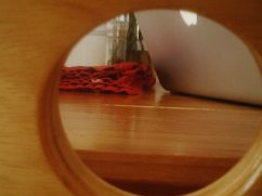The view through one of the holes in his chair.
