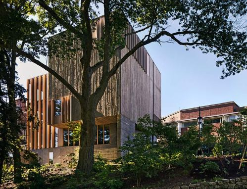 Pendleton West's board-formed concrete facade creates a textured, tree bark-like exterior that connects the building to its beautiful, wooded site. ©Michael Moran/OTTO