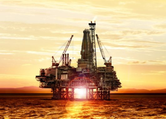 gas production on the sea at sunrise, platform