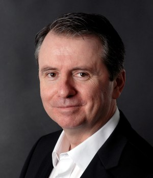 A headshot of Alex McMullan, EMEA CTO for Pure Storage, a cloud storage provider