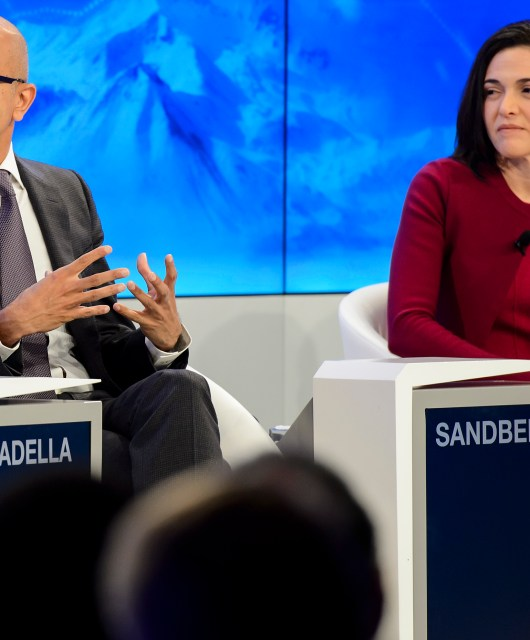 CEO of Microsoft Corporation Satya Nadella, left, and Chief Operating Officer of Facebook Sheryl Sandberg, right, speak during a panel session on the first day of the Annual Meeting of the World Economic Forum, WEF, in Davos, Switzerland, Wednesday, Jan. 20, 2016. (Jean-Christophe Bott/Keystone via AP)