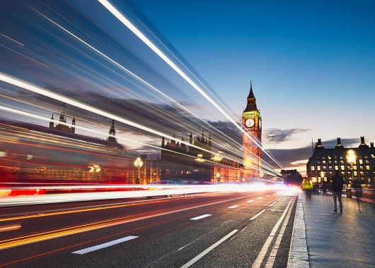 Light trails on the Westminster bridge after sunset. Big Ben and House of Parliament in London, The United Kingdom of Great Britain and Northern Ireland