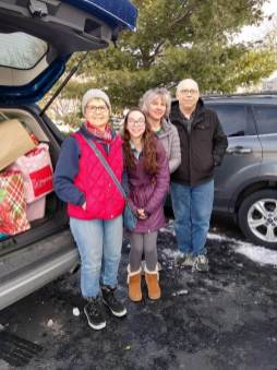 Maxine Anstett, treasurer of St. Mary's LOC, Julia a Junior Lady of Charity, her mom Colleen Kajdas from the Women's Bible Study group WINGS, and Mike Walter, Holly's husband