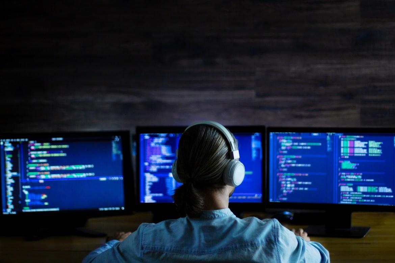 AI Dynamics Developer Cover - Software developer freelancer man male with white headphones